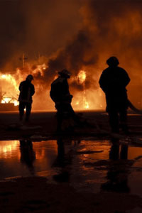 Fire fighters at night