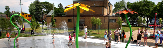Kids playing at a Kingston City splash pad