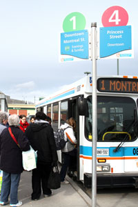 Transit riders boarding a bus