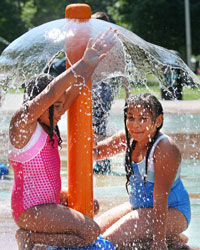 GIrls playing in the splash pad at City Park