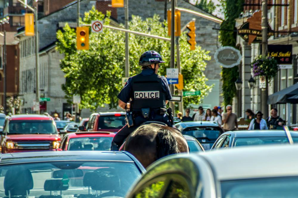 18546210_1492391457519_Wading into Traffic - An officer on patrol during the Canada Day celebrations