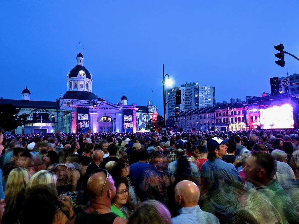19191608_1495847051025_Saying good bye to the band... - A packed crowd of fans watching Tragically Hip's last concert in Kingston