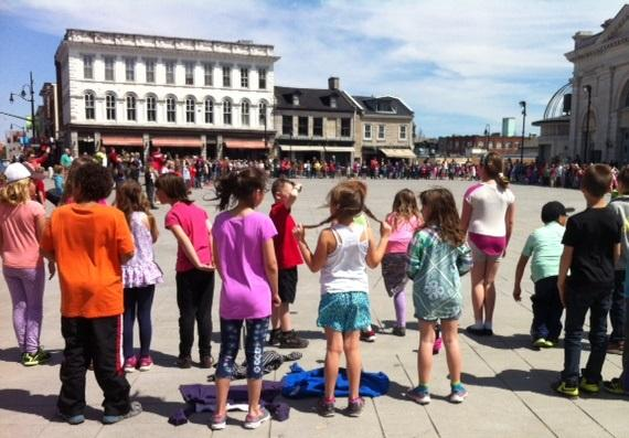 3307774_1491852179158_Kids in the Square - Kids in Springer Market Square for a singalong.