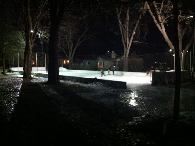 3307774_1492544048334_Night hockey - The hockey rink looks great lit up at night at McBurney Park.