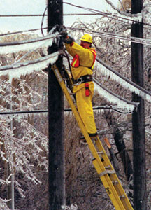 Hydro worker fixing power line after ice storm