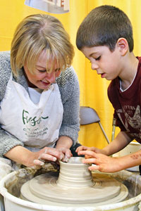 Teacher & Child using a pottery wheel